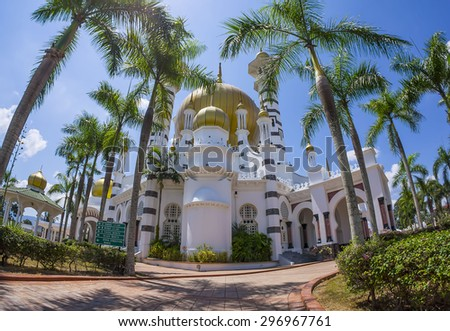 KUALA KANGSAR - AUGUST 9: Atmosphere at Ubudiah Mosque on August 9, 2013 in Perak, Malaysia. The mosque was built in 1917 and list as Malaysia's most beautiful mosques. - stock photo