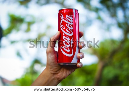Kuala Lipis , Pahang , Malaysia 1st August 2017 - Hand Holding Coca Cola Can In Selective Focus Over Blur Background