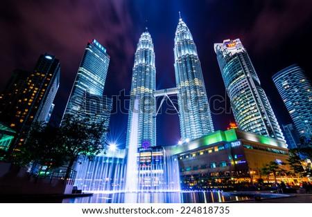 Kuala Lumper, Malaysia - April 08, 2014: KUALA LUMPUR, MALAYSIA - April 08: Petronas Twin Towers at night scene - stock photo