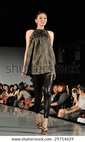 KUALA LUMPUR - APRIL 2 :A model displays creation by Venie Tee during STYLO Fashion Grand Prix April 2, 2009 in Kuala Lumpur. The fashion show was held in conjunction with Malaysian F1 Grand Prix.
