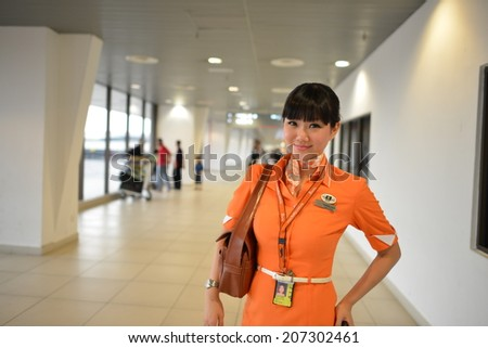 KUALA LUMPUR-APRIL 27: crew member on April 27, 2014 in Kuala Lumpur, Malaysia. FlyFirefly Sdn Bhd is a full-service point-to-point carrier and a full subsidiary of Malaysia Airlines. - stock photo