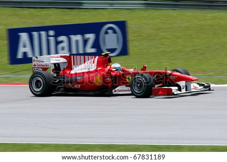 KUALA LUMPUR - APRIL 3: Ferrari's driver Fernando Alonso races down the track on practice day at the 2010 Petronas Malaysia Grand-Prix on April 3, 2010 in Sepang International Circuit, Malaysia.