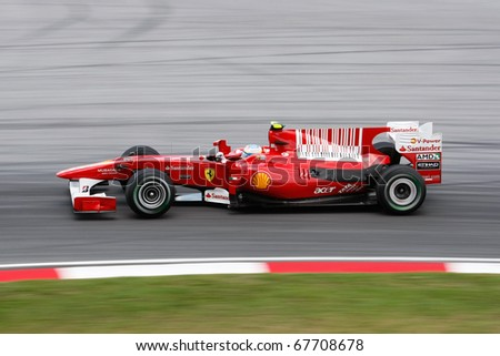 KUALA LUMPUR - APRIL 2: Ferrari's driver Fernando Alonso takes to the tracks on practice day at the 2010 Petronas Malaysia F1 Grand-Prix on April 2, 2010 in Sepang, Malaysia. - stock photo