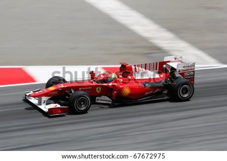 KUALA LUMPUR - APRIL 2: Ferrari's Felipe Massa takes to the tracks on practice day at the 2010 Petronas Malaysia F1 Grand-Prix on April 2, 2010 in Sepang, Malaysia. - stock photo