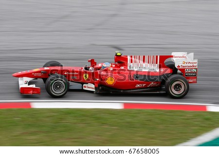 KUALA LUMPUR - APRIL 4: Scuderia Ferrari driver Fernando Alonso takes the hairpin turn on race day at the 2010 Petronas Malaysia Grand-Prix on April 4, 2010 in Sepang International Circuit, Malaysia.