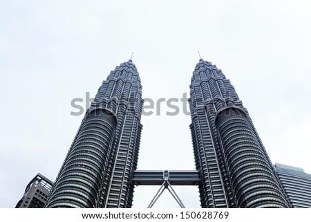 KUALA LUMPUR - APRIL 28: View of The Petronas Twin Towers on April 28,2013 in Kuala Lumpur, Malaysia. It is famous landmark of Malaysia. Petronas Twin Towers are the tallest twin buildings in the world (451.9 m). - stock photo