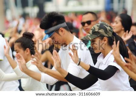 KUALA LUMPUR -  Aug 27 :Crowd dance the traditional choreography during the rehearsal for National Day parade on Aug 27,2015 at Bangunan Sultan Abdul Samad ,Dataran Merdeka, Kuala Lumpur, Malaysia - stock photo