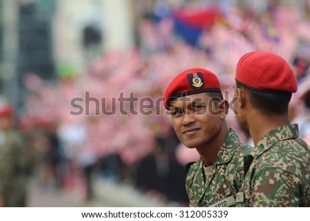 KUALA LUMPUR - Aug 27:Officer from Kor Polis Tentera DiRaja (Royal Military Police Corps) observing the security during rehearsal for National Day parade on Aug 27,2015 at Dataran Merdeka,Kuala Lumpur - stock photo