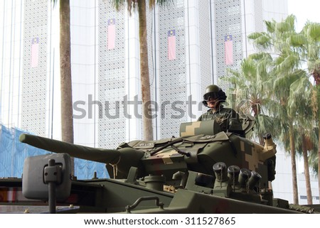 KUALA LUMPUR -  Aug 27 : Unidentified soldier posing with tank from  the Royal Malaysian Armed Forces during the rehearsal for National Day parade on Aug 27,2015,Dataran Merdeka,Kuala Lumpur, Malaysia - stock photo