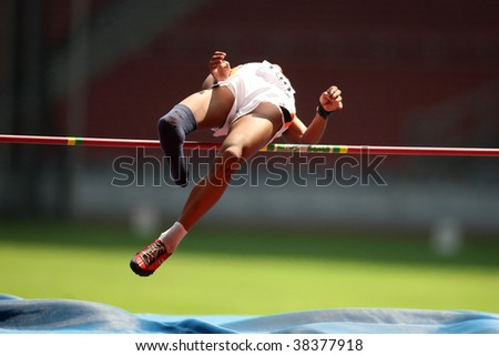 KUALA LUMPUR - AUGUST 16: Amputee high jump athlete in a successful jump at the track and field event of the fifth ASEAN Para Games on August 16, 2009 in Kuala Lumpur, Malaysia. - stock photo