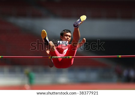 KUALA LUMPUR - AUGUST 16: Amputee high jump athlete in a successful jump at the track and field event of the fifth ASEAN Para Games on August 16, 2009 in Kuala Lumpur, Malaysia.