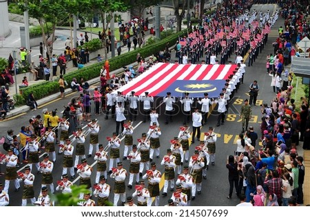 KUALA LUMPUR - AUGUST 31: Large flag of malaysia stretchered during 57th Celebrations, Malaysian Independence Day Parade on August 31, 2014 in Kuala Lumpur, Malaysia.  - stock photo