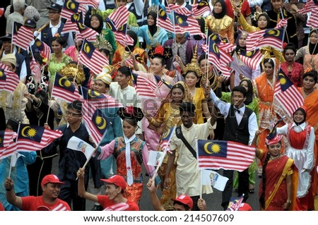 KUALA LUMPUR - AUGUST 31: Multi ethnic with traditional wear during 57th Celebrations, Malaysian Independence Day Parade on August 31, 2014 in Kuala Lumpur, Malaysia.  - stock photo