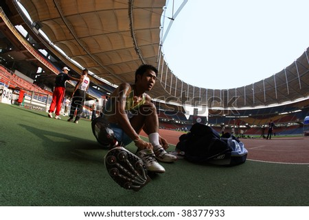 KUALA LUMPUR - AUGUST 16: Thailand's amputee runner prepares his running prosthesis at the track and field event of the fifth ASEAN Para Games on August 16, 2009 in Kuala Lumpur, Malaysia.