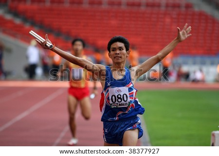 KUALA LUMPUR - AUGUST 18: Thailand's visually impaired relay team wins the 4x400m race at the track and field event of the fifth ASEAN Para Games on August 18, 2009 in Kuala Lumpur, Malaysia. - stock photo