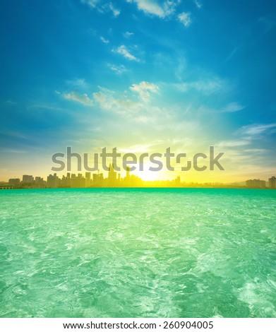 Kuala Lumpur city center sunrise view from luxury infinity swimming pool, beautiful natural golden sunlight. - stock photo