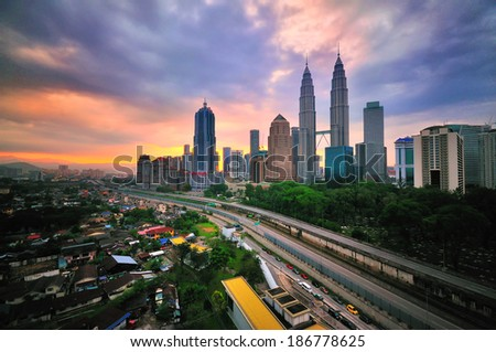 Kuala Lumpur City Centre during sunrise from rooftop of building - stock photo