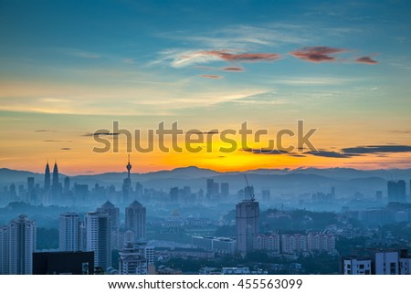 Kuala Lumpur cityscape at dawn, clear sky with ground fog - stock photo