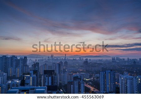 Kuala Lumpur cityscape at dawn with colorful cloudy sky, viewed from Mont Kiara, east of KL