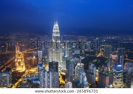 Kuala Lumpur cityscape showing Petronas twin tower, also known as KLCC building during blue hour from the KL tower - stock photo
