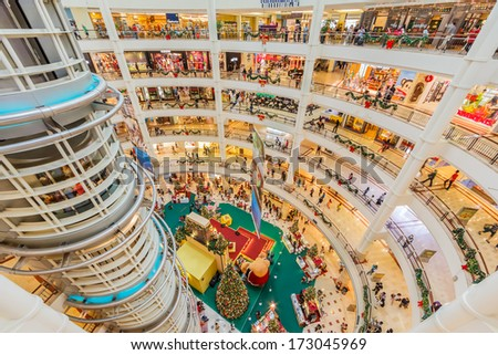 KUALA LUMPUR - DECEMBER 23: People shop at Suria KLCC on Dec 23, 13 in Kuala Lumpur, Malaysia. It is an end to end Developer and Asset Manager of Retail Assets in Malaysia. - stock photo
