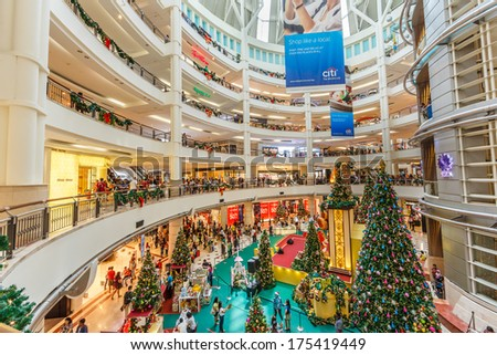 KUALA LUMPUR - DECEMBER 23: People shop at Suria KLCC on Dec 23, 13 in Kuala Lumpur, Malaysia. It is an end to end Developer and Asset Manager of Retail Assets in Malaysia.