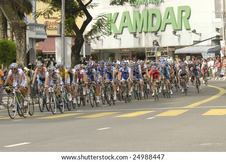 KUALA LUMPUR - FEBRUARY 15 : Cyclists participate in the Le Tour de Langkawi cycling race on February 15, 2009 in Kuala Lumpur, Malaysia.