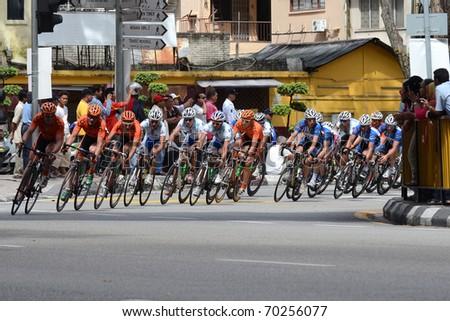KUALA LUMPUR - FEBRUARY 1 : Cyclists participate in the Le Tour de Langkawi cycling race on February 1, 2011 in Kuala Lumpur, Malaysia. - stock photo