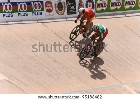 KUALA LUMPUR - FEBRUARY 9: Rider from China (red) competed with rider from Hongkong (green white) during Asian Cycling Championships 2012 held in Kuala Lumpur, Malaysia on February 9, 2012. - stock photo