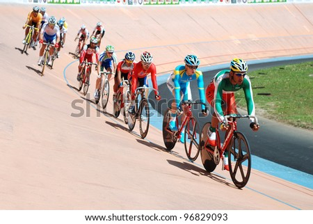 KUALA LUMPUR - FEBRUARY 11: Rider from Iran leads in the Keirin race category during the Asian Cycling Championships 2012 in Kuala Lumpur, Malaysia on Saturday, February 11, 2012 - stock photo
