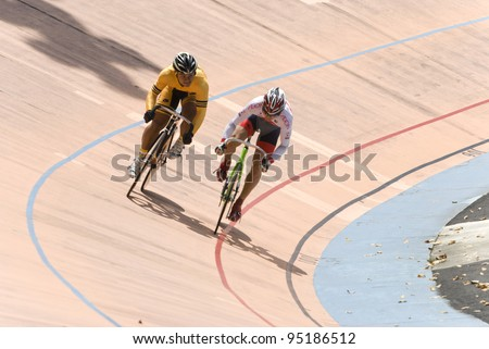 KUALA LUMPUR - FEBRUARY 9: Rider from Malaysia (left) competed with rider from Japan (right) during Asian Cycling Championships 2012 held in Kuala Lumpur, Malaysia on February 9, 2012. - stock photo