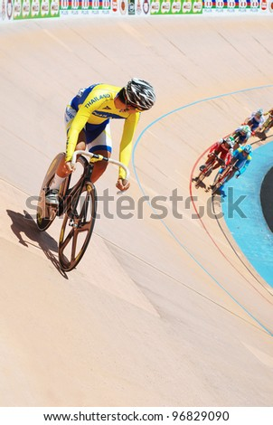 KUALA LUMPUR - FEBRUARY 11:Rider from Thailand looks at the other riders in Keirin race category during the Asian Cycling Championships 2012 in Kuala Lumpur, Malaysia on Saturday, February 11, 2012 - stock photo