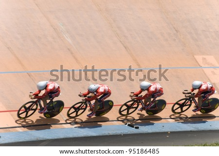KUALA LUMPUR - FEBRUARY 9: Riders from Hongkong race on team pursuit during Asian Cycling Championships 2012 held in Kuala Lumpur, Malaysia on February 9, 2012. - stock photo