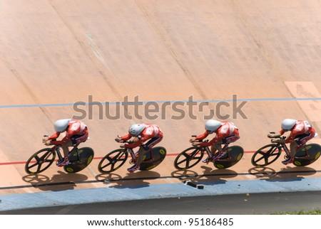 KUALA LUMPUR - FEBRUARY 9: Riders from Hongkong race on team pursuit during Asian Cycling Championships 2012 held in Kuala Lumpur, Malaysia on February 9, 2012. - stock photo