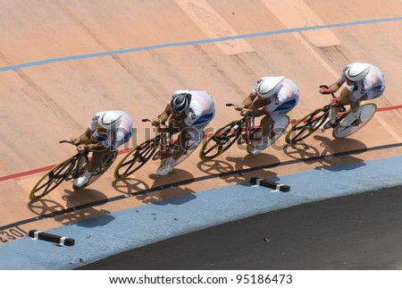 KUALA LUMPUR - FEBRUARY 9: Riders from Korea race on team pursuit during Asian Cycling Championships 2012 held in Kuala Lumpur, Malaysia on February 9, 2012. - stock photo