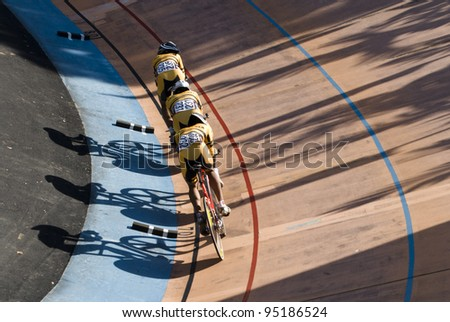 KUALA LUMPUR - FEBRUARY 9: Riders from Malaysia race on team pursuit during Asian Cycling Championships 2012 held in Kuala Lumpur, Malaysia on February 9, 2012. - stock photo