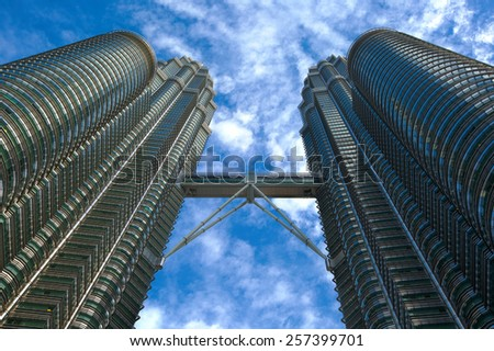 KUALA LUMPUR - FEBRUARY 5: The Petronas Twin Towers on February 5, 2015, in Kuala Lumpur, Malaysia are the world's tallest twin tower. The skyscraper height is 451.9m - stock photo