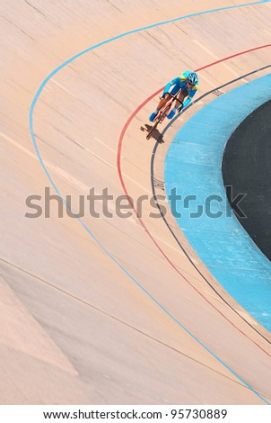 KUALA LUMPUR, FEBRUARY 11: Unidentified rider from Kazakhstan participates in sprint event during the Asian Cycling Championships 2012 at the Kuala Lumpur Velodrome, Malaysia on February 11, 2012 - stock photo
