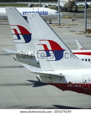 KUALA LUMPUR INTERNATIONAL AIRPORT - JULY 18, 2014: Malaysia Airlines aircraft tail logo at KLIA, Sepang, Malaysia. Malaysia Airlines MH17 crashes on Ukraine-Russia border today, killing 295 people - stock photo