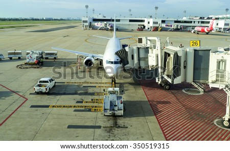 Kuala lumpur International airport (KUL), Malaysia - November 3, 2015: Airplane at dock load and unload for next air freight. Aircraft plane at terminal gate perpare and waiting for passenger, traveller