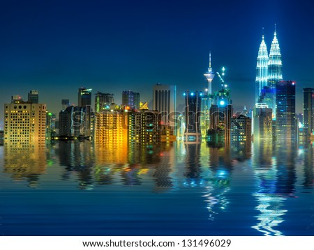 Kuala Lumpur is the capital and the largest city of Malaysia, view with water reflection. - stock photo