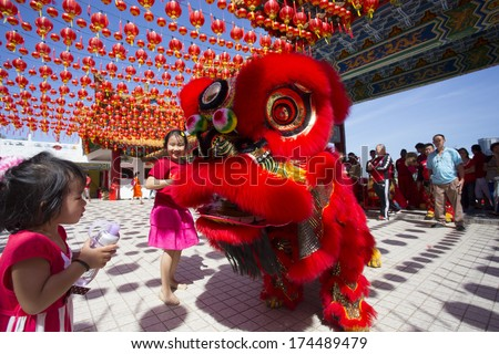 KUALA LUMPUR-JAN 31: Malaysian Traditional Lion Dance performs a dance routine outside the Thean Hou Temple during Chinese New Year celebrations on January 31, 2014 in Kuala Lumpur, Malaysia. - stock photo