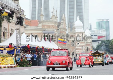 KUALA LUMPUR - JAN 28: Vintage and antique cars participate during the Federal Territory Day celebration parade on Jan 28, 2012 in Dataran Merdeka, Kuala Lumpur, Malaysia