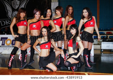KUALA LUMPUR - JANUARY 05: KL Dragons' cheer leaders, The Dragonettes poses before the game at the ASEAN Basketball League match January 05, 2010 in Kuala Lumpur. - stock photo