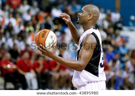 KUALA LUMPUR - JANUARY 05: KL Dragons' Jamal brown in action against Satria Muda BritAma at the ASEAN Basketball League match January 05, 2010 in Kuala Lumpur. - stock photo