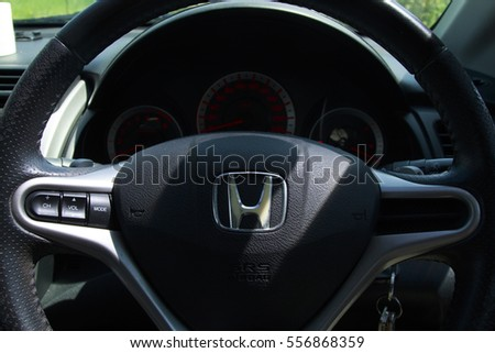 KUALA LUMPUR, January 13, 2016 : View of HONDA steering and meter. Focus on HONDA logo. A crop close up steering wheels