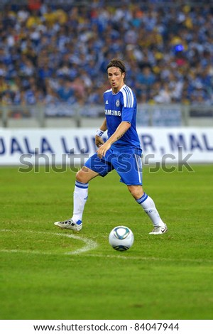 KUALA LUMPUR, July 21 : Chelsea's Fernando Torres in action during a preseason match agains Malaysia on July 21, 2011 in Kuala Lumpur, Malaysia. Chelsea won 1-0 - stock photo