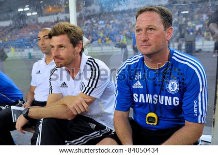 KUALA LUMPUR, JULY 21:Chelsea's manager Andre Villas-Boas (C) Roberto Di Matteo (L) Steve Holland (R) sitting on bench during a preseason match against Malaysia on July 21, 2011 in Kuala Lumpur - stock photo