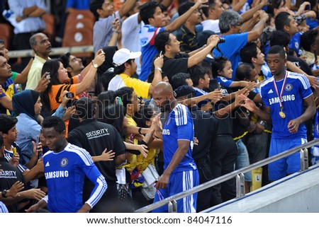 KUALA LUMPUR, July 21 : Chelsea's Mikel (L) Anelka (center) and Chalobah (R) shaking hands with fans during a preseason match agains Malaysia on July 21, 2011 in Kuala Lumpur, Malaysia.