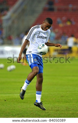 KUALA LUMPUR, JULY 21 : Chelsea's Nathaniel Chalobah warm-up during a preseason match against Malaysia on July 21, 2011 in Kuala Lumpur, Malaysia. Chelsea won 1-0 - stock photo
